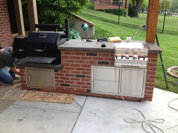 Yoder YS480 Wood-Fire BBQ incorporated into an outdoor kitchen