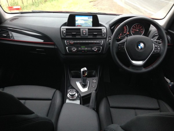 The full front interior of the BMW 116i
