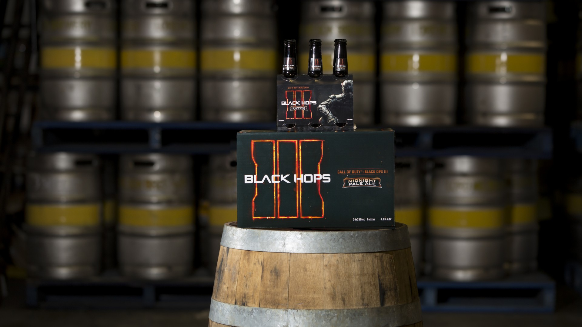 Call of Duty Black Hops Beer - bottles and case on barrel
