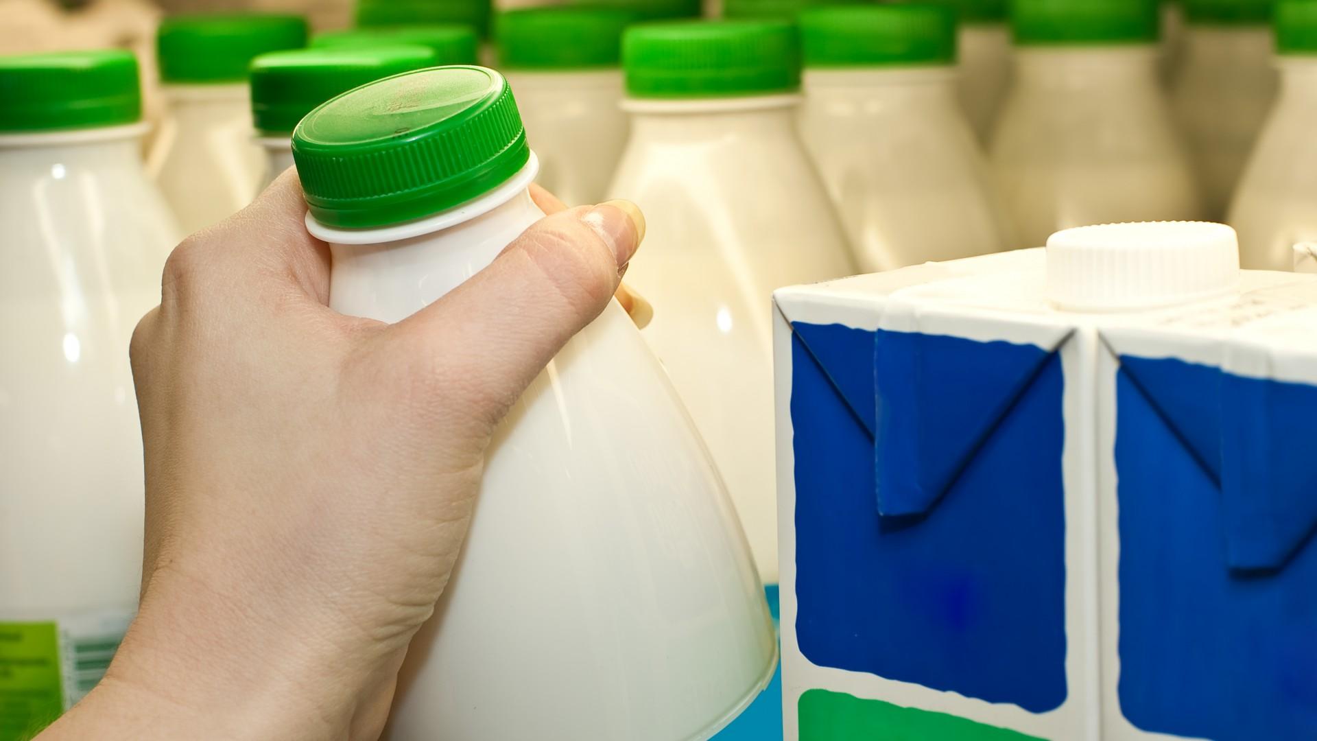 pulling-milk-botle-from-store-supermarket-shelf