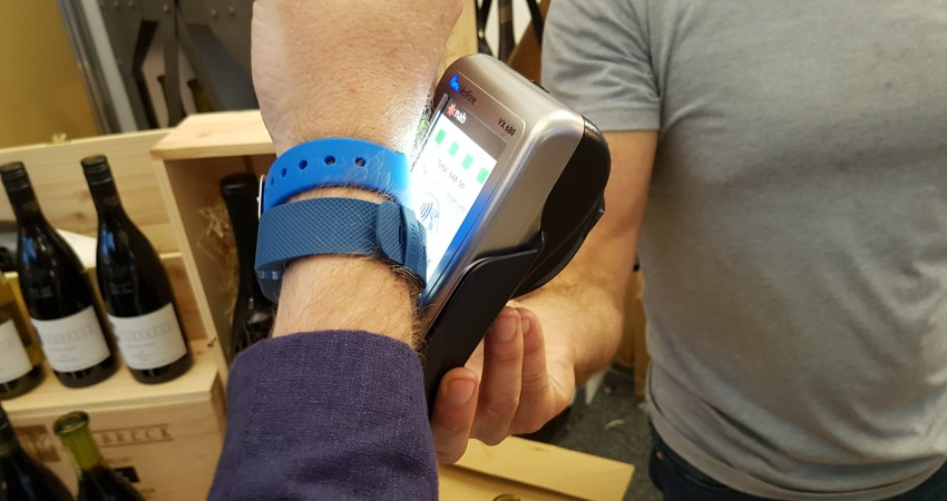 An Optus Pay band above the FitBit