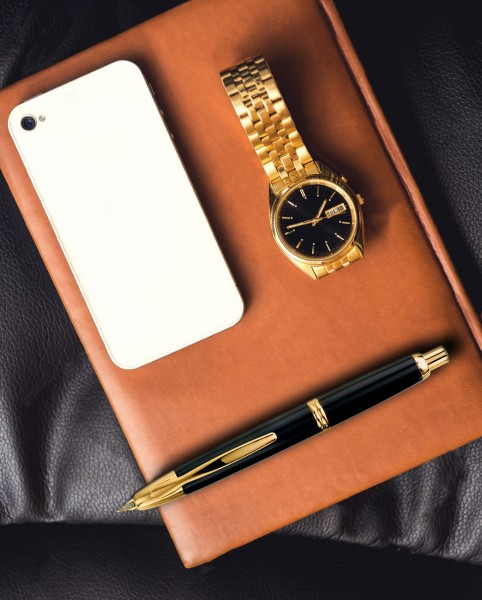 capless-gold-flat-lay-gold-and-brown-book