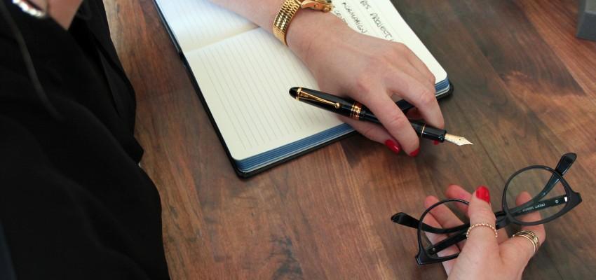 custom-743-womans-hand-on-desk