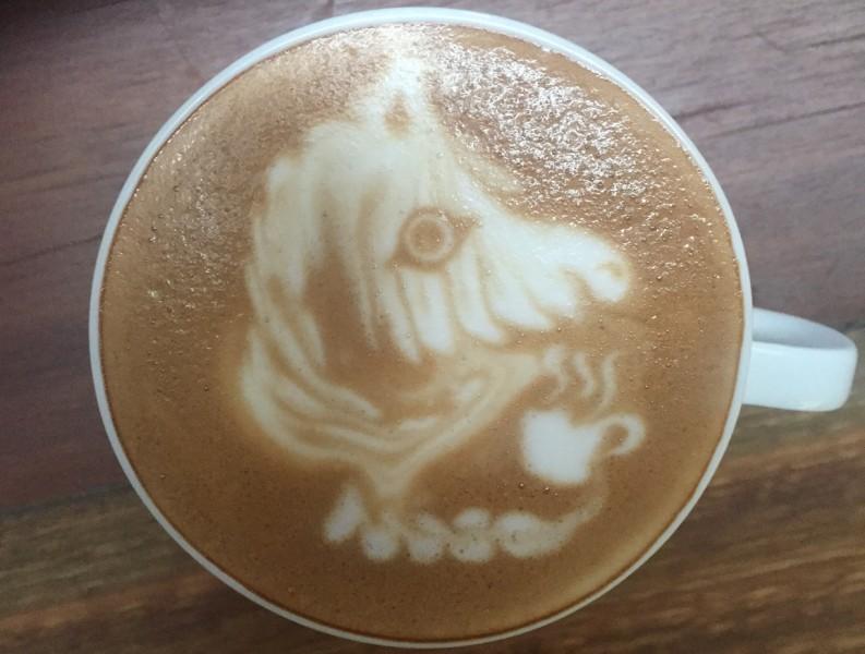 A Zebra drinking coffee