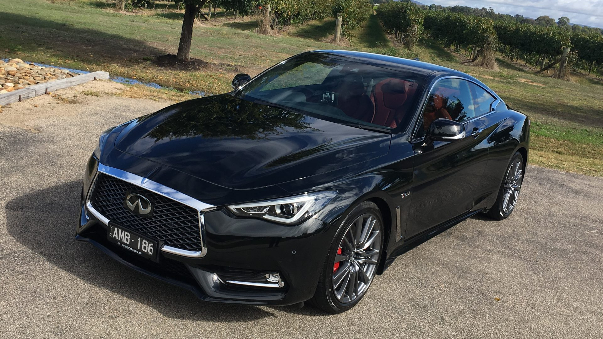 first drive infiniti q60 red sport a performance coupe worth a look eftm. Black Bedroom Furniture Sets. Home Design Ideas