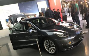 Long queues to check out the Tesla Model 3 in…