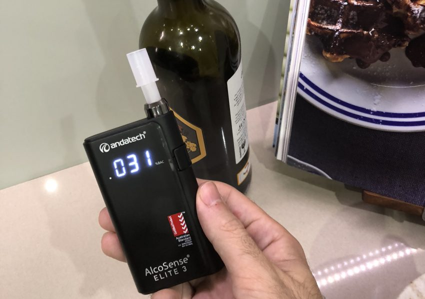 Alcosense Elite 3 with a bottle of wine