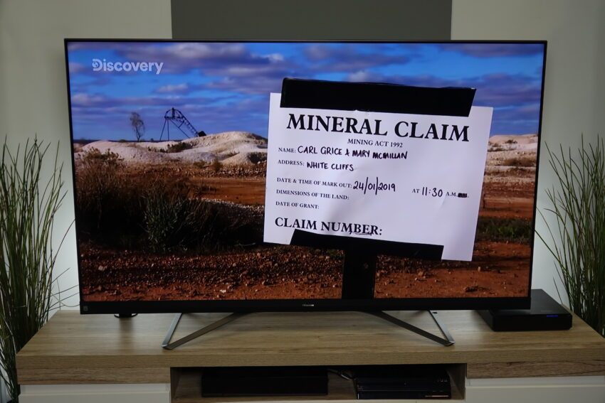 A photo of the TV showing a Discovery Channel SHow