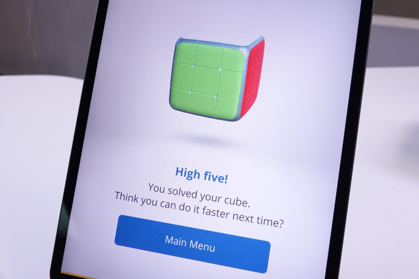 iPad showing GoCube app with successful completion message