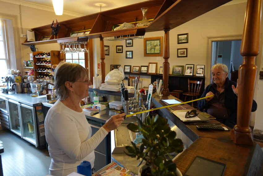 Suesann Long and Garry Fairley, maintaining a safe social distance at the Walcha Road Hotel