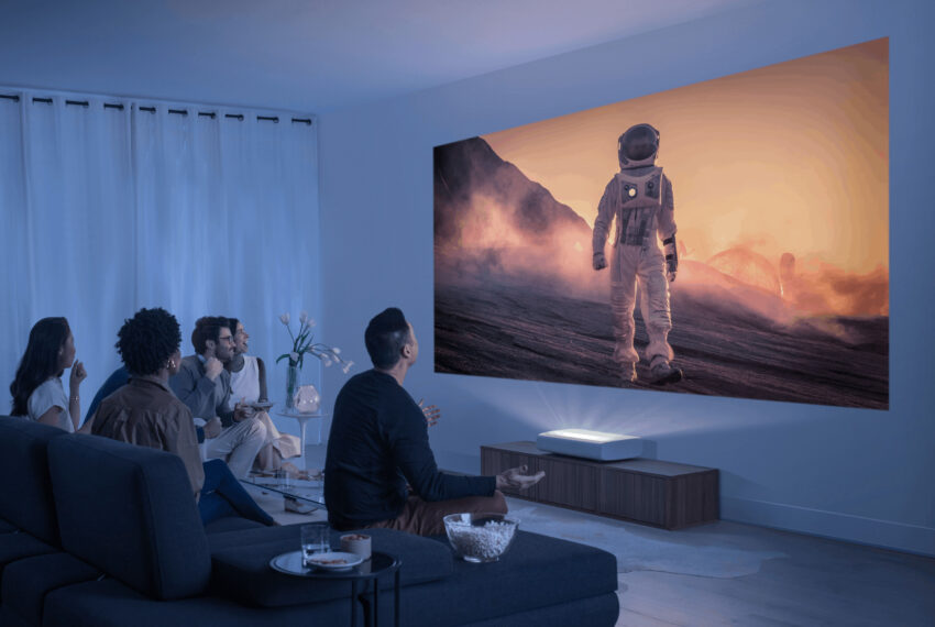 A group looks at the short-throw Premier projector from Samsung