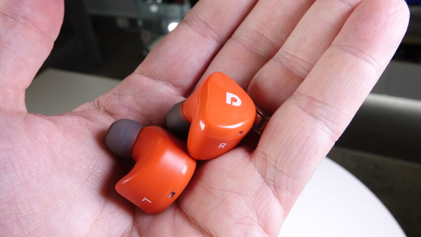 Two Audiofly AFT2 earphones held in the palm of a hand
