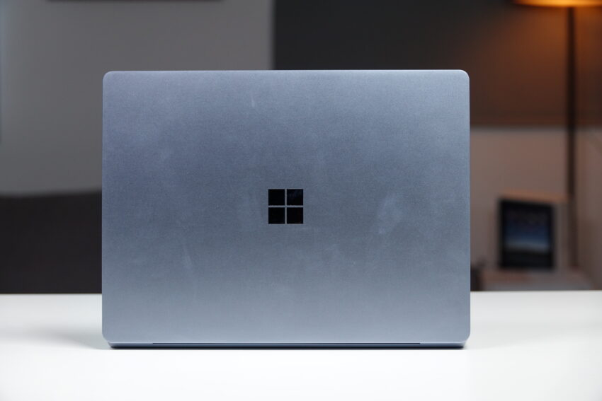The Microsoft Logo on the top of the laptop
