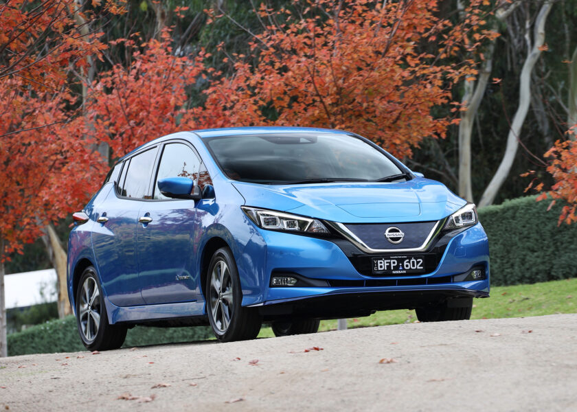 Nissan Leaf e+ surrounded by trees