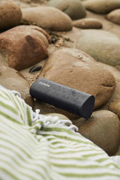 a Sonos Roam speaker on the rocks